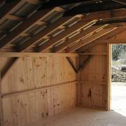 13x20 Barn with hemlock posts, beams angle braces, rafters and roof strapping