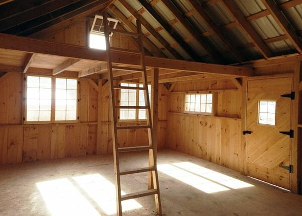Post and beam Vermont Cottage includes the floor system, siding and metal roofing