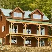 Vermont Cabin with doghouse dormers, overhang, floor system, basement beams and client supplied windows and doors
