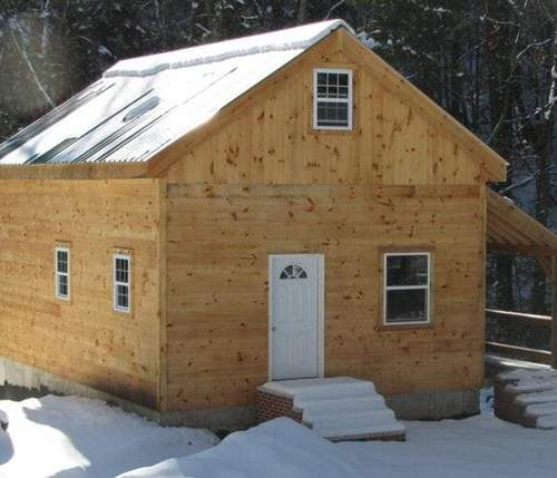 20x30 Vermont Cabin with overhang, installed on a full foundation.