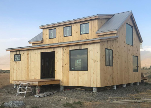j600 square foot cabin with an addition and shed dormer.