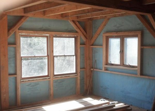 Vapor barrier installed in a timber frame Vermont Cabin.