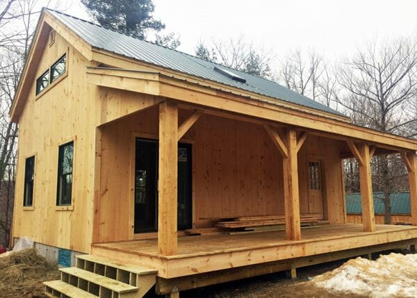 Vermont Cabin with covered porch, floor system and client supplied windows.