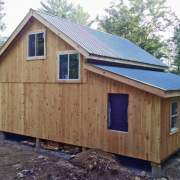 20x30 Vermont Cabin modified with two overhangs. One of the overhangs is being enclosed to create an additional room.
