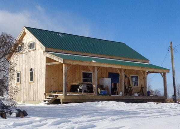 This 20x40 Cabin is shown with a covered porch add on. Additional modifications were made by the client.