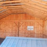 The two bay simple garage is constructed of a post and beam hemlock frame on a pressure treated sill plate. A concrete slab foundation is recommended.