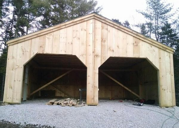 24x24 Simple Garage build in progress with rough sawn hemlock frame and pine board and batten siding