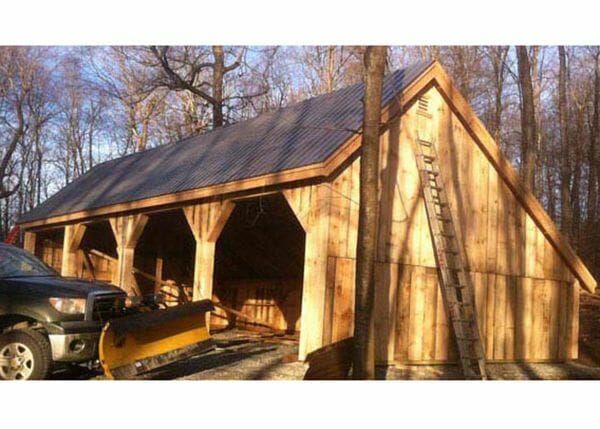 24x48 Equipment Shed - post and beam barn with charcoal gray metal roof