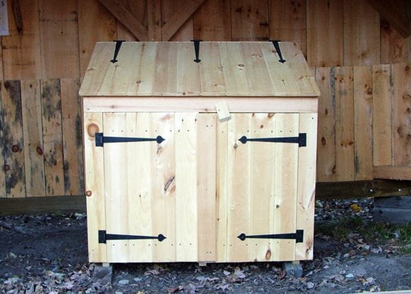 The 2x4 Garbage Bin uses a wooden latch to keep the double doors shut