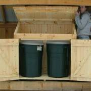 Two large trash cans fit inside this 2x4 Garbage Bin