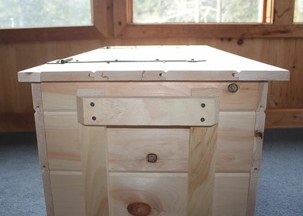 The pellet box includes pine handles on the sides for easy pick up