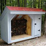 4x10 Weekender firewood storage shed customized to have red metal roof and painted blue