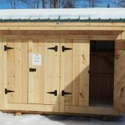 4x10 Garbage Shed with two double doors, evergreen metal roof with overhang and pine board siding