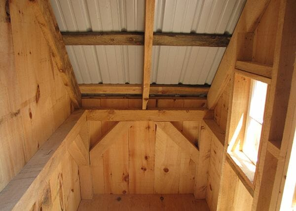 4x10 Hardwrae Shed interior showing off the post and beam frame and barn sash window