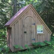 4x10 Hardware Shed stained with red roof and larger window