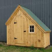 The 4x10 Hardware Shed includes pine board and batten siding, evergreen roof, 16x21 fixed barn sash window and arched door.