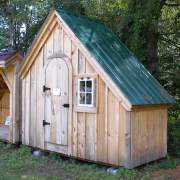 4x10 Hardware Shed includes a cute arched door and small barn sash window