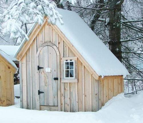 The 4x10 Hardware Shed includes an arched door and small barn sash window.