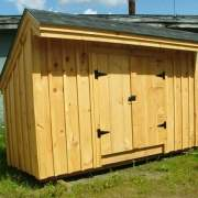 This mini shed works well for storing trash cans and recycling.