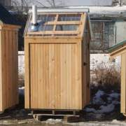 This functional outhouse was modified to have a clearpoly roof and tongue and groove siding