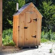 4x4 Working Outhouse with a clear roof and crescent moon cutout in the door