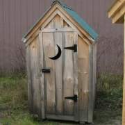 4x4 Outhouse Shed includes green metal roof, pine board and batten siding and a single door with moon cutout