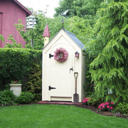 4x4 Outhouse Shed painted white with a charcoal gray metal roof upgrade