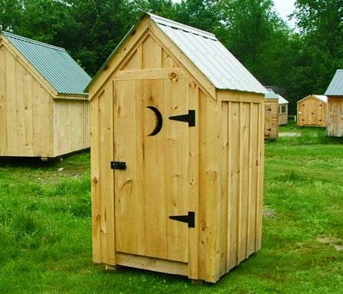 4x4 Outhouse Shed with metal roof, board and batten siding and door with moon cut-out