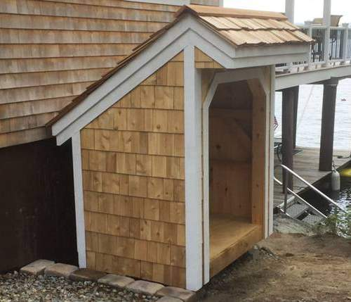 4x6 Bus Stop with red cedar shingle siding and roofing and painted white pine tirm