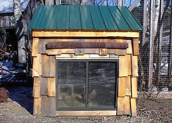 Chicken Coop with cedar shake siding and a sliding window