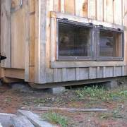 4x6 Coop with two hinged windows near the floor.