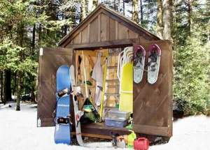 Custom 6x4 Utility Shed being used to store winter sports equipment and gardening tools