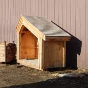 4x8 Hearthstone with a cedar shingle roof with solid pine roof sheathing