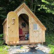 8x10 Hardware Shed with door open to get a peek inside. This one is being used as a camping cabin.