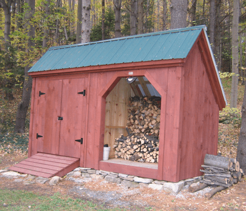 Painted 6x14 Weekender combination firewood storage shed with a set of double doors and PT ramp