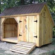 6x14 Weekender post and beam firewood storage shed with double doors and ramp. tudor brown roof upgrade