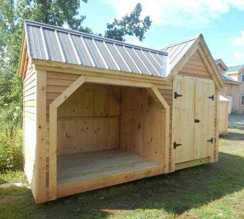 6x16 Vermont Gem firewood storage shed with gray metal roof and cedar clapboard siding