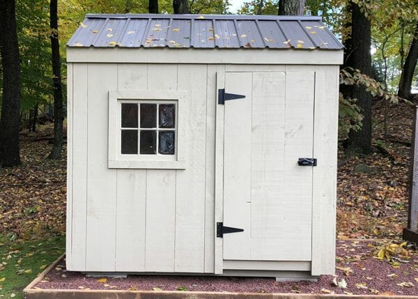 6x8 Nantucket storage shed painted gray with a black metal roof