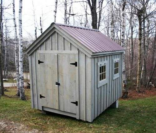 8x10 Gable with brown roof and gray painted sides. Includes a double door and two hinged windows