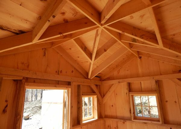 Post and beam Cross Gable Cottage with air-dried pine roof sheathing