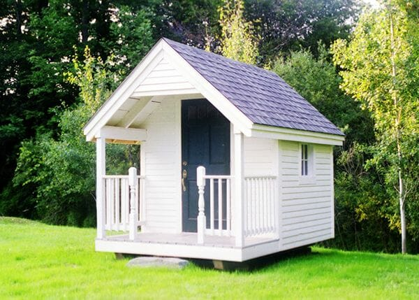 8x12 Garden Shed with asphalt shingle roof, antique door, clapboard siding and porch railling