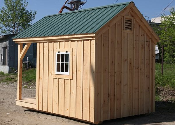 8x12 Garden Shed - standard exterior includes an evergreen metal roof, barn sash widnows, board and batten siding and a covered porch.