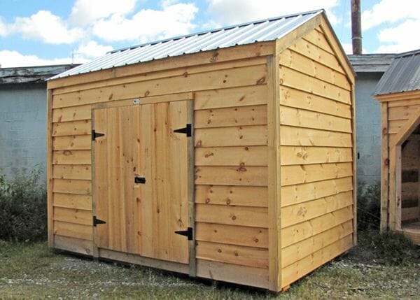 8x12 New Yorker customized with Live Edge Pine Siding and a Silver Galvanized Corrugated Metal Roof