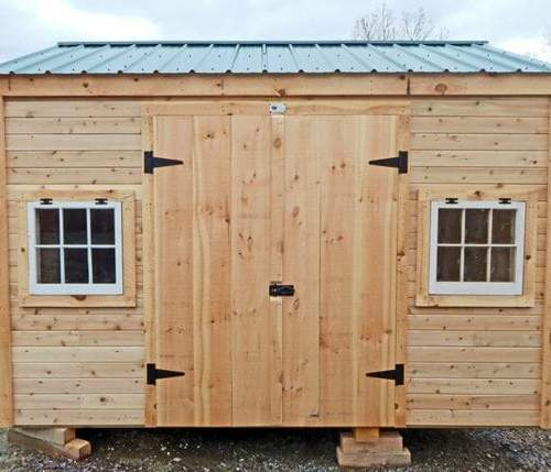 This New Yorker storage shed was customized with the addition of two hinged barn sash windows and horizontal tongue and groove siding
