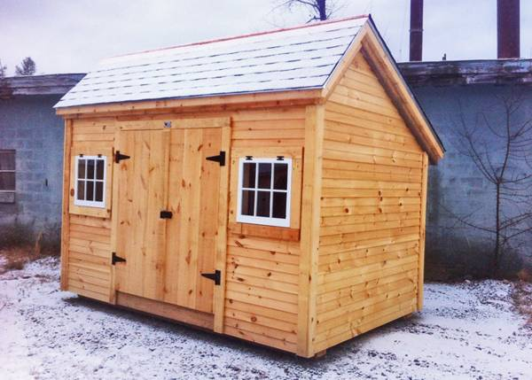 8x12 Church Street is a storage shed that includes two hinged barn sash windows and a set of double doors with a treated ramp