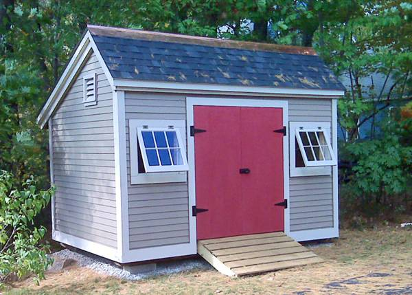 Painted 8x12 Church Street storage shed with red double doors and a pressure treated ramp
