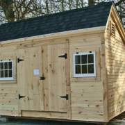 8x12 Church Street post and beam shed with clapboard siding and an asphalt shingle roof