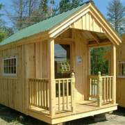 8x12 Garden Shed with porch railing, full glass door and larger windows