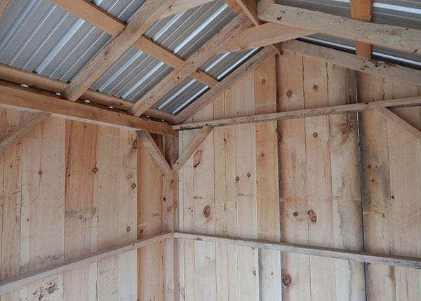 8x12 New Yorker basic shed interior featuring the 4x4 hemlock frame with angle braces and 2x4 rafters.