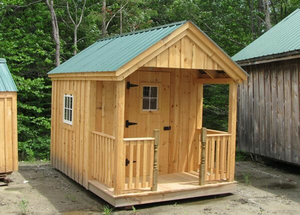 8x12 Nook post and beam cabin with porch. Porch railing and half newel posts were an add-on